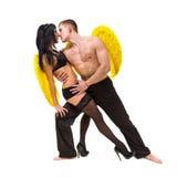 Молодые сексуальные пары с желтыми крылами Стоковое Изображение