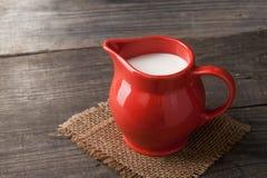 Молоко в стеклянном кувшине на белой предпосылке Стоковые Фото