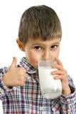 молоко мальчика выпивая Стоковые Изображения RF