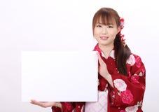 Молодая азиатская женщина в кимоно Стоковая Фотография