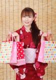 Молодая азиатская женщина в кимоно Стоковое Изображение RF