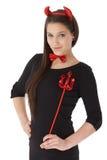 Молодая женщина в усмехаться costume дьявола Стоковое Изображение RF