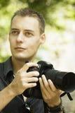 Молодой фотограф Стоковое Фото