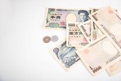 Монетка банкнот японских иен и японских иен Стоковая Фотография RF