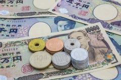 Монетка банкнот японских иен и японских иен Стоковое Изображение RF