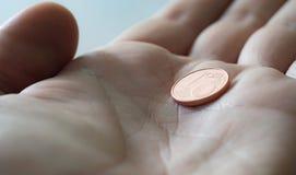 Монетка в руке Стоковые Фотографии RF