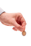 Монетка евро 2 в руке человека Стоковые Изображения RF