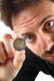 Монетка евро 2 в руке Стоковое Изображение RF