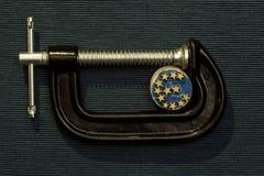 Монетка евро давление струбцины Стоковые Фото