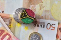 Монетка евро с национальным флагом Вануату на предпосылке банкнот денег евро Стоковые Изображения RF
