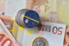 Монетка евро с национальным флагом Науру на предпосылке банкнот денег евро Стоковая Фотография RF