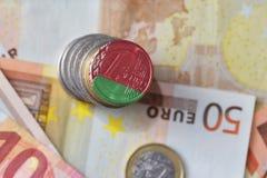 Монетка евро с национальным флагом Беларуси на предпосылке банкнот денег евро Стоковые Фотографии RF