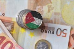 Монетка евро с национальным флагом Иордании на предпосылке банкнот денег евро Стоковое Изображение RF