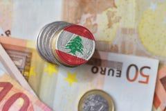 Монетка евро с национальным флагом Ливана на предпосылке банкнот денег евро Стоковое Изображение RF