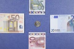 Монетка и банкноты евро Стоковые Фотографии RF