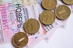 Монетка и билет Стоковое Изображение