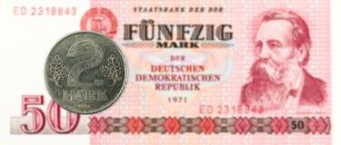 монетка 2 меток против исторические 50 восточного - банкнота немецкой метки стоковые фото