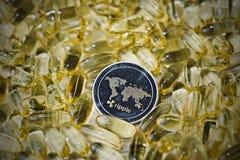Монетка пульсации в желтых лекарствах Стоковое Изображение RF