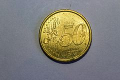 Монетка цвета золота цента евро 50 стоковая фотография rf