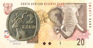 монетка южно-африканского ранда 2 против южно-африканского ранда 20 стоковое фото