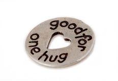 Монетка hug знака внимания стоковые изображения