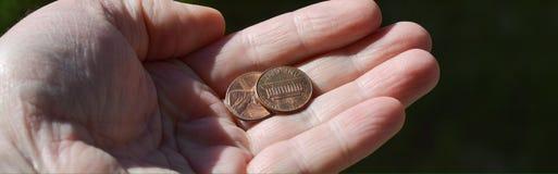 Монетки в руке Стоковая Фотография