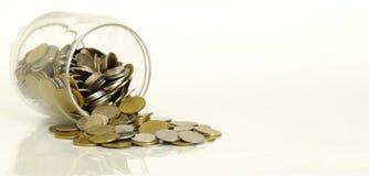 Монетки в стеклянной бутылке Стоковое Изображение RF
