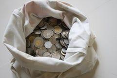Монетки в сумке Стоковые Изображения