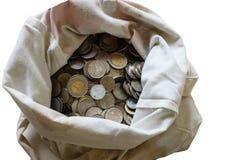 Монетки в сумке Стоковые Фото