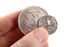 Монетки доллара в людской руке Стоковая Фотография