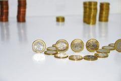 Монетки евро на белой таблице Стоковое фото RF