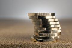 Монетки евро на таблице Стоковые Изображения