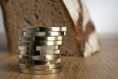 Монетки евро с хлебом Стоковые Фотографии RF