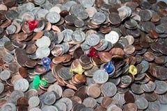 Монетки и пешки Стоковая Фотография