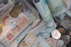 Монетки и примечания фунта Стоковые Изображения RF