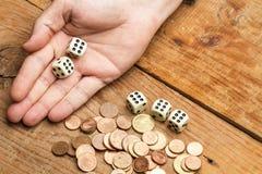 Монетки и dices Стоковые Изображения RF