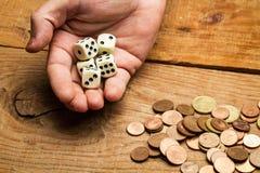 Монетки и dices Стоковая Фотография