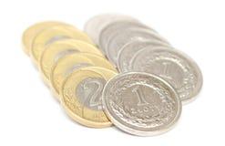 Монетки на белой предпосылке Стоковая Фотография RF