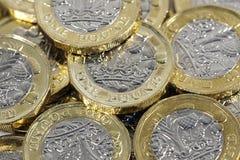 Монетки одного фунта - великобританская валюта Стоковое Фото