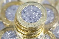 Монетки одного фунта - великобританская валюта Стоковые Фотографии RF