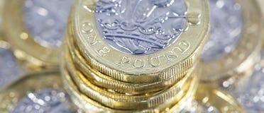 Монетки одного фунта - великобританская валюта Стоковая Фотография RF