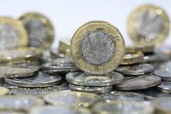 Монетки одного фунта - великобританская валюта Стоковое фото RF
