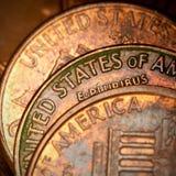 монетки предпосылки стоковые фото