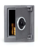 монетки раскрывают сейф Стоковая Фотография