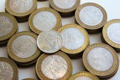 Монетки 10-рубля юбилея русские и символ рубля Стоковое Фото