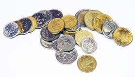 монетки складывают различное Стоковое фото RF