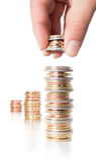 Монетки стога с рукой - увеличивая доходом Стоковые Фото