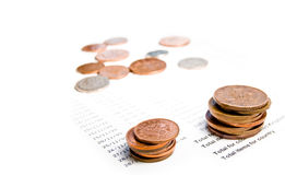 монетки счетов английские стоковая фотография rf