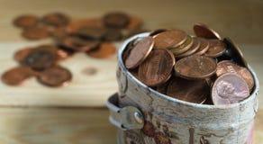 Монетки США в коробке металла Стоковая Фотография