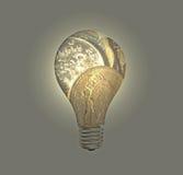 Монетки фунта в лампочке Стоковое фото RF